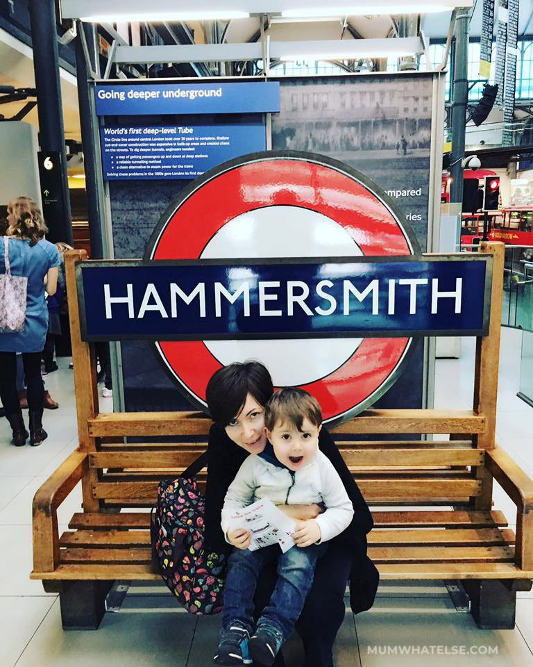 a mum and his child on a bench in the London Transport Museum