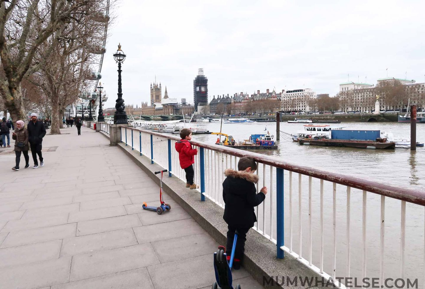 Two kids along the South Bank facing the Thames and the Big Ben