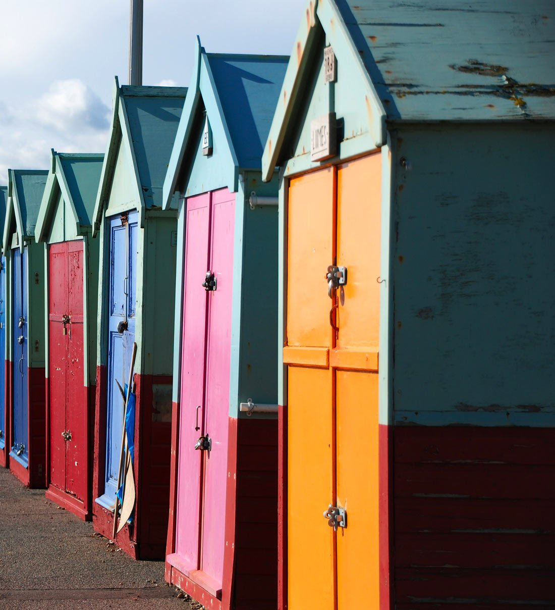 little houses along the beach in Brighton