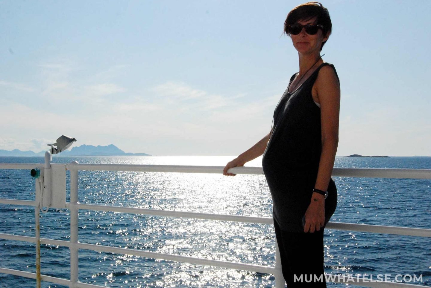 A pregnant woman on a ferry on the sea