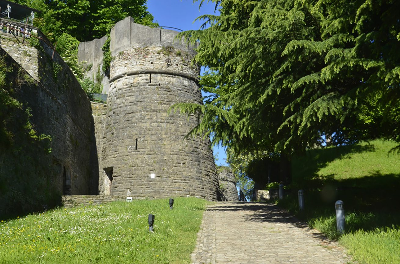 San Vigilio Castle in Bergamo Upper Town, there is a tower and trees