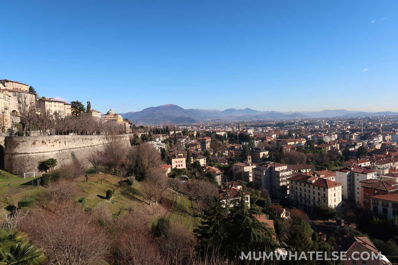 Panorama with the walls of Bergamo and the mountains on a clear day