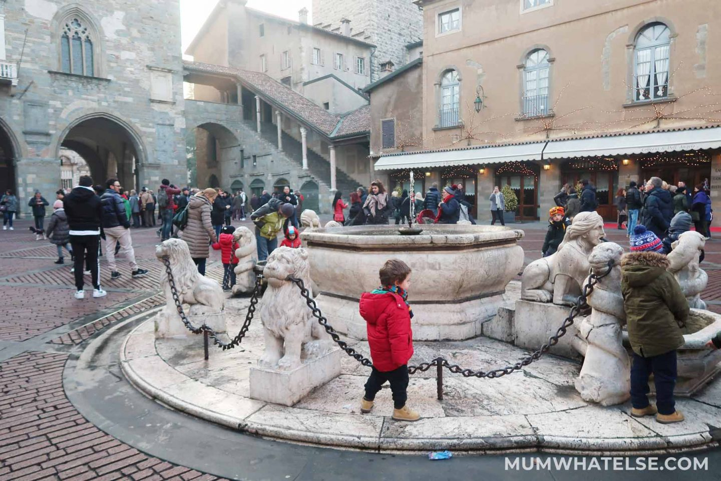 Fontana Contarini in Piazza Vecchia in Bergamo with children around who play