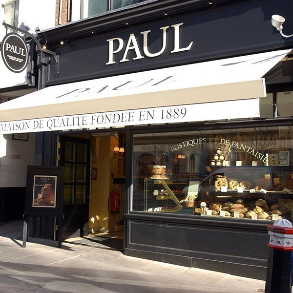 Paul bakery from outside with the window full of pastreis