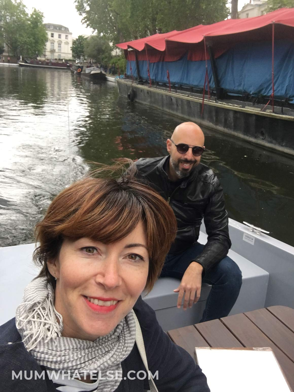 Two people in boat smiling