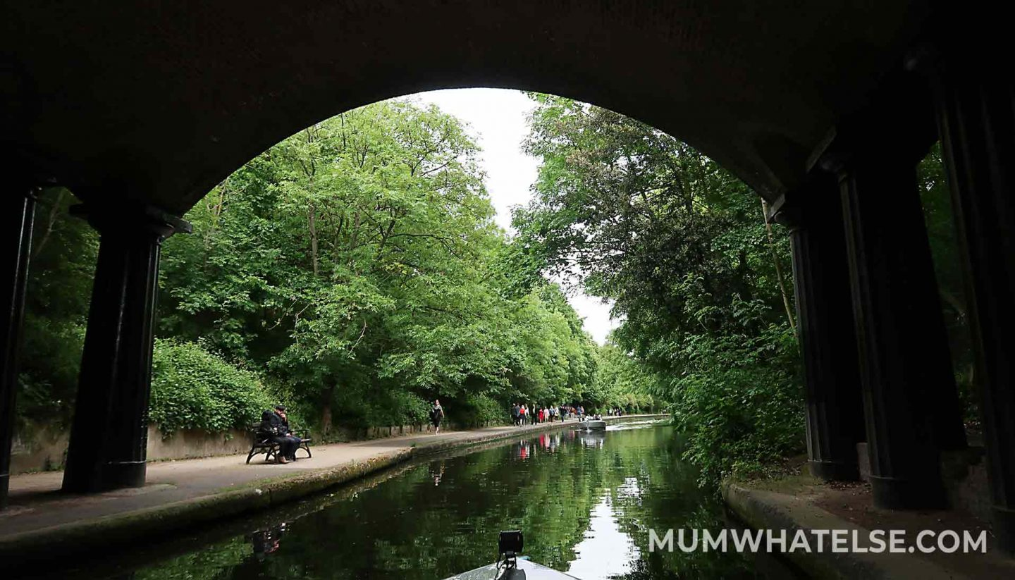 London canals - a boat and a canals into the wood