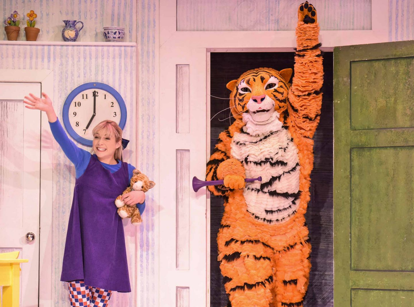 Jocelyn Zackon as Sophie, David Scotland as Tiger wave at the audience