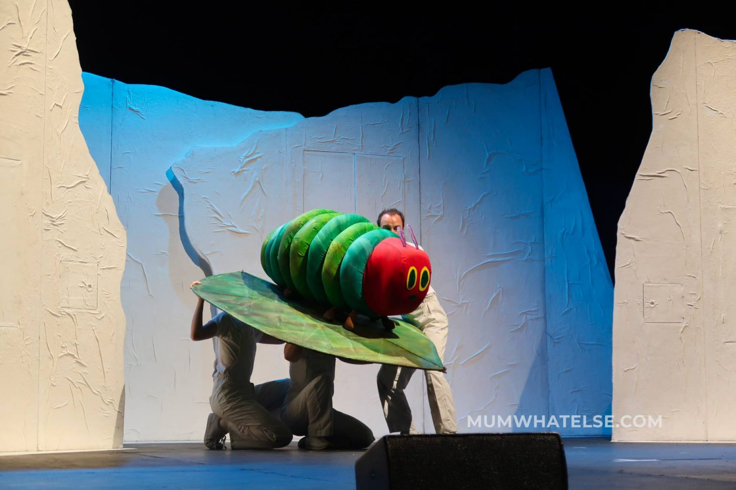 a caterpillar puppet on stage