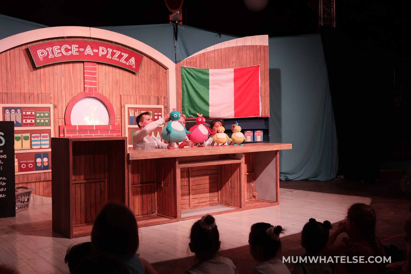 four people with 4 puppets on stage