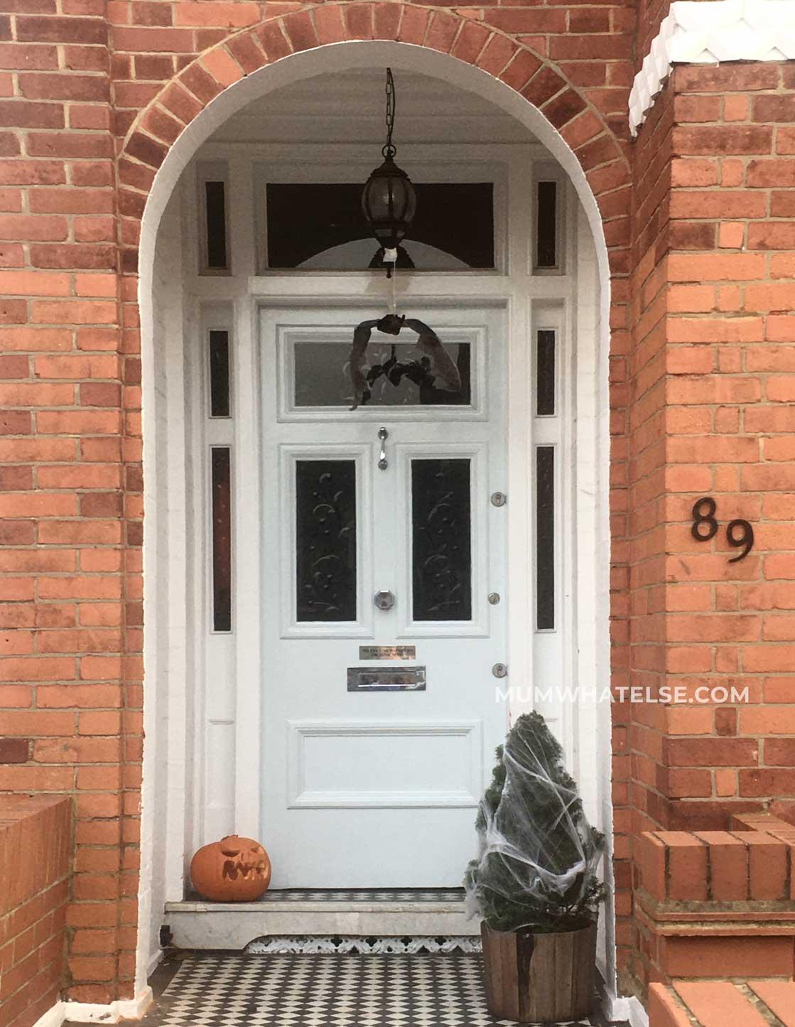 white door with a bat hanges
