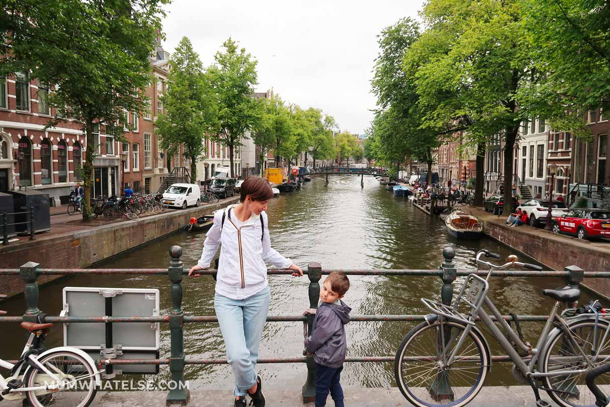 a mum and her son in front of a canal in Amsterdam