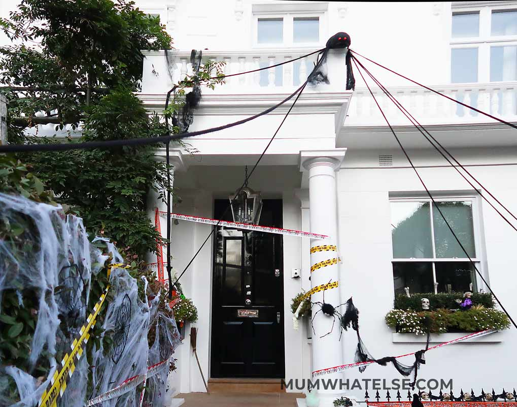 white house with spiders hanging in London