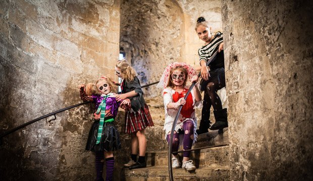 some kids in costume on the stairs