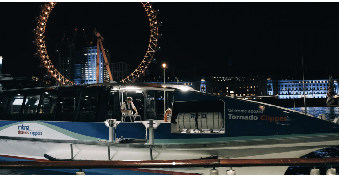 a boat on the Thames river and the London eye